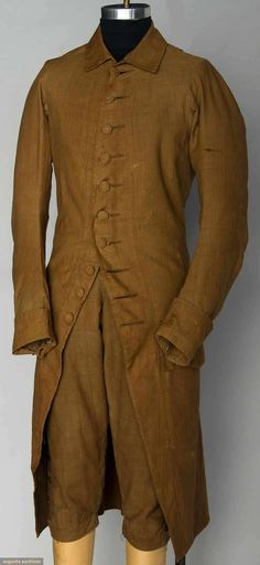 """RARE MIDDLE CLASS MAN'S DAY SUIT, AMERICA, 1780s Brown linen suit dyed w/ butternuts: 1 unlined jacket w/ self fabric buttons, 10 front & 2 back, 2 pockets w/ flaps, Ch 36"""", L 43""""; 1 pair matching breeches lined w/ natural linen, waist band laces CB, 6 brass knee buttons, W 30""""-32"""", Inseam 17"""", (knee band missing buckles & replaced w/ buttons, some fade spots on coat & breeches) excellent."""