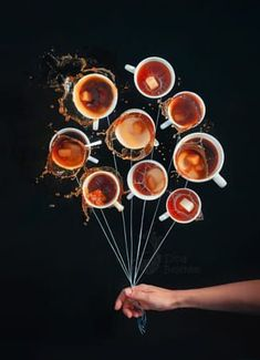 8 Amazing Flat Lay Photography Ideas A creative flat lay still life with 10 cups of coffee arranged in a circle with strings attached and a persons hand holding the strings as if it was a bunch of balloons