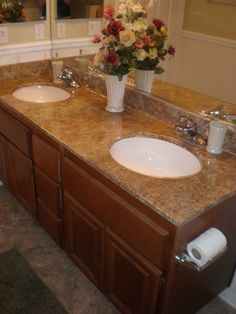 Brave, but it looks great- totally fake granite look on marble countertops