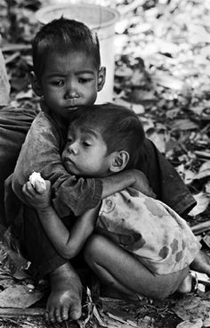 Children alone. Older brother trying to care for younger one.