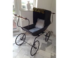 Antique baby carriage.