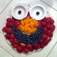 Elmo fruit tray.  Id put yogurt or white fruit dip in the little bowls for the eyes. Cute idea for a kids party- or fruit tray for the kids at a party.....could do oscar with vegtables for us instead of strawberries red raspberries