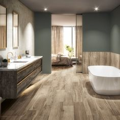 This beautiful bathroom was created using the P series coolwood range. A porcelain stoneware collection using digital printing to create a wood effect. Available in 10 colours, sized House, Home Projects, Home, Space Interiors, House Styles, New Homes, Bathroom Interior, Bathroom, Tile Bathroom
