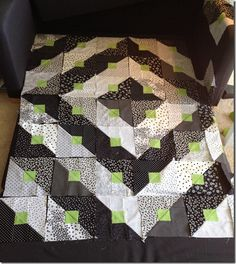 Disappearing Log Cabin: Easy and Cool Block. Fourth step is to sew the blocks together to come up with the Paradigm Shift Quilt. Black, white and blue would look great!