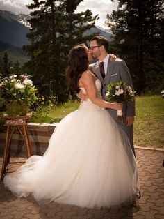 David's Bridal bride Taren in a strapless tulle White by Vera Wang ball gown with her groom at their rustic glam wedding in Banff. #DavidsBridalCanada