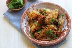 **REALLY GOOD! SUPER CRISPY EVEN NEXT DAY AS LEFTOVERS** Pok Pok Fish Sauce Wings [mine turned out exactly like pic. Added splash of soy sauce and grated ginger. Factor in 3hrs marination time. Must be on high heat for sauce to cook down syrupy - seriously constant stirring and DO NOT walk away for a sec, it will burn quickly. Fish sauce smell not as bad once cooked down]