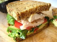 Chicken Sandwich with Avocado. there is a sandwich like this at Panera Bread called a Turkey BLT with Avocado. It is the freshest simple sandwich I've ever eaten. Steak Sandwiches, Healthy Sandwiches, Delicious Sandwiches, Delicious Recipes, Great Recipes, Favorite Recipes, Chicken Avocado Sandwich, Healthy Snacks, Healthy Recipes