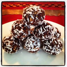 Raw Vegan Power Balls  Myra Sarikaya Process: 1 cup raw almonds, 1 cup dates, 4 tbsp. raw carob powder, 1 tbsp. mesquite, 1 tbsp. maca, 1 tbsp. acai powder, pinch of ground vanilla, pinch of Himalayan salt. Shape into balls, roll into unsweetened dried coconut. Devour!