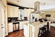 Giallo Fiesta granite countertops... idea for wall/cabinet color