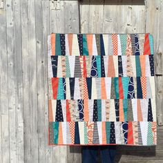 Wonky Stripes baby quilt finished. Had to get a picture of it in front of Dad's barn. His makes for a better backdrop than ours does!