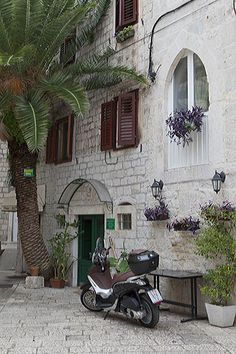 Moped by old house, Trogir, Croatia