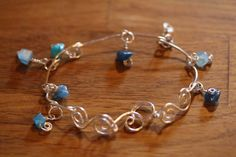 Silver Wire Bracelet with Turquoise colored by SilverLeatherStudio