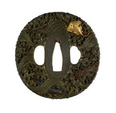Tsuba with Fish and Waves Several fish are depicted among turbulent waves, including a sting ray, mackerel and puffer fish. This is part of a mounted set in which the tsuba, fuchi, kozuka, and kogai are all signed by Ômori Hidetomo. 1742-1807 (late Edo)