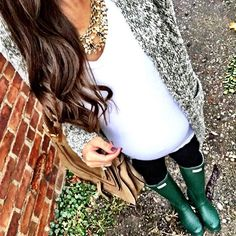 IG @mrscasual <click through to shop this look> Olive green marled sweater cardigan.  White tee.  Statement necklace.  Maternity leggings.  Green hunter boots.  Chloe marcie bag.