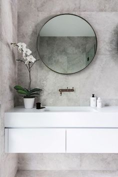 After three stages of renovations and withthe help of an interior designer friend Nikki Yazxhi creator and editor of lifestyle website bellaMUMMA and husband Adam creative director at Maxco finally completed their Forever family home. Bathroom Inspo, Bathroom Inspiration, Modern Bathroom, Bathroom Ideas, Bathroom Grey, Bathroom Remodeling, Bathroom Mirrors, Minimalist Bathroom, Small Bathrooms