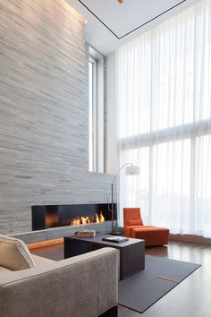 Interior of the 73rd Street Penthouse by Turett Collaborative Architects. Beautiful stone wall. - love everything