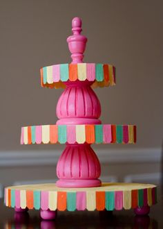 DIY Cupcake Stand - i pinned a better one before, but love that this one has dollhouse shingles on it.