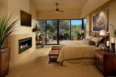 Un design et décoration éclectique pour cette chambre à la cheminée moderne
