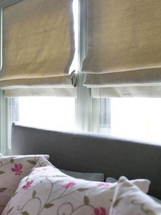 Flat Roman shades-characterized by flat edge at the bottom and suitable for both masculine & feminine spaces.HGTV