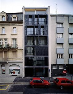 Herzog & de Meuron - Schützenmattstrasse apartments, Basel 1993. The operable iron sun shades reference storm drains found throughout Basel, Is there anything I love more than when buildings don't match?