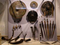 Bronze Age : Arm and armour  - National Museum of Ireland with the famous : Clonbrin leather shield (right)  - Cloonlara  wood shield (center) - Lough Gur bronze shield (left)