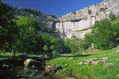 Malham Cove, Yorkshire    This dramatic natural limestone amphitheatre in North Yorkshire can be seen from miles away - a heavy white-grey scar against green hills. Peregrines nest high up on the cliff face, and the cove is catnip to climbers.