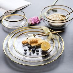 Timeless style meets contemporary design in the Opaque Dining Collection. Round clear glass plates & bowls with gilt rims. Clear Glass Plates, Glass Dishes, Classic Dinnerware, Dinnerware Sets, Dining Plates, Dessert Spoons, Dinner Sets, Dinner Ware, Dish Sets