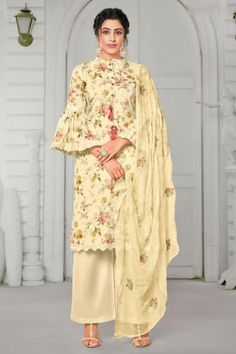 Enhance your ethnic charm by wearing this pale yellow cotton trouser suit which will keep you comfortable and easy on the eye at the next social function. This Chinese collar neck and 3/4th sleeves comfy attire elaborated using digital print floral work. Matched with cotton palazzo pant in pale yellow color with pale yellow chiffon dupatta. This trouser suit can be customized up to maximum size 44 inches. #Cotton #Trousersuit #Malaysia #Andaazfashion