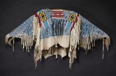 IMPORTANT NEZ PERCE BEADED AND FRINGED HIDE WAR SHIRT