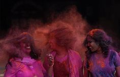 Girls react after colored powder is thrown on them during Holi celebrations in the southern Indian city of Chennai March 11, 2009