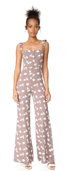 bardot jumper by Flynn Skye. This floral Flynn Skye jumpsuit has a tailored bodice and wide-leg pants. Fabric-covered buttons secure the front, an...