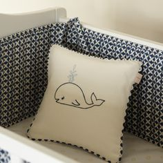 We love our new embroidered nursery pillows! This pillow features a wily little whale and reverses to our Charleston Indigo print. Mixand match these pillows with our Charleston Crib Accessories. Filledwith a clusterfiber insert. 10