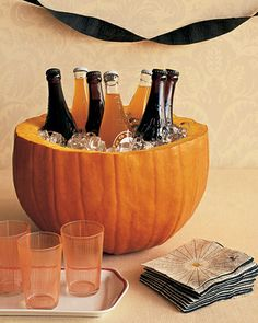 Halloween Craft: Pumpkin Party Cooler (Could use as a punch bowl, too.) Put bowl in pumpkin before putting in punch or ice. Soirée Halloween, Adornos Halloween, Manualidades Halloween, Holidays Halloween, Halloween Treats, Halloween Parties, Halloween Drinks, Halloween Clothes, Halloween Punch