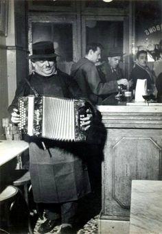 The accordionist Paris 1955,by Robert Doisneau