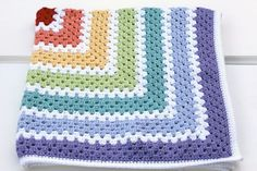 Really like the colours and order colours with white in between. I think a Granny Stripe would work well in this pattern and colour combo as well as this one giant granny square blanket. Pastel rainbow colours granny square blanket