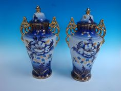 "Presenting for your consideration is this very beautiful pr. Of Flow Blue Urns, 18"" overall ht., 10"" w, (handle to handle ) and 7"" depth, heavy gilding both on the handles and the floral decoration. Excellent overall condition."