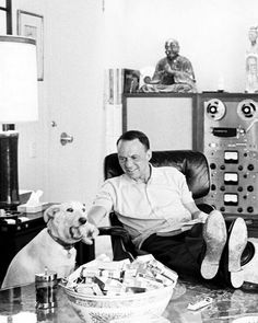 Frank Sinatra at home resting with his dog