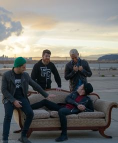 Chilling on a couch in the middle of now where because you're fall out boy