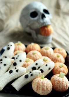 A few tricks for some healthful Halloween treats -- #recipes for tangerine pumpkins, banana ghosts, string cheese broomsticks and veggie skeletons. #HalloweenFoods