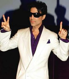 Prince | Prince proves he's a hypocrite by holding up two different numbers.