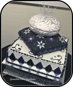 Purple, Black and Silver Pillow Wedding Cake by Graceful Cake Creations, via Flickr