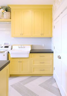 Yellow and gray laundry room features yellow shaker cabinets paired with charcoa. Yellow and gray laundry room features yellow shaker cabinets paired with charcoa. Yellow and gray laundry room features yellow shaker cabinets paired with charcoa. Laundry Room Cabinets, Painting Kitchen Cabinets, Kitchen Paint, Kitchen Tiles, Kitchen Colors, Yellow Cabinets, White Shaker Cabinets, Grey Cabinets, Upper Cabinets