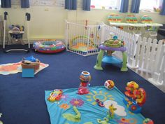 infant day care rooms- love the picket fence gate to separate the eating area and the little safety zone around the one floor toy for very little ones so they don't get trampled by the bigger movers