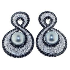 @diamondgirl1975.  I am obsessing over these Tahitian #pearl earrings with black and white #diamonds by TA Fine Jewelry.