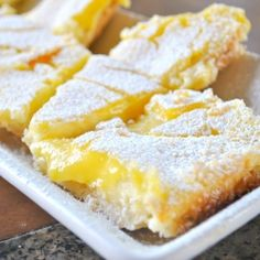 Triple Layer Lemon Bars...a shortbread crust with a tangy lemon and cream cheese filling topped with delicious lemon curd