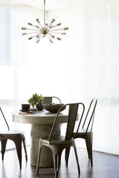 Neutral dining room with modern chandelier