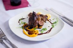 Roasted rump of Romney saltmarsh lamb  with roast potatoes, honey roasted parsnips, butternut squash puree, redcurrant gravy