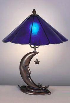 hermosa lámpara en acero y cobalto