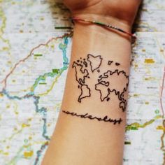 the world is on your wrist tattoo