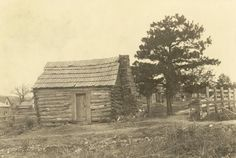 Historical Photos of McAlester | The beginning of South McAlester with a log cabin and pine tree. 1880s, possibly earlier. Credit goes to Steve Adams of McAlester, OK